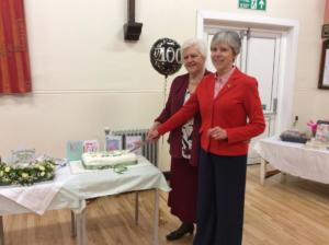 Proud President of Scotby WI Helen Mrowicki cuts the cake with help from Federation Chairman Ilene Forsyth